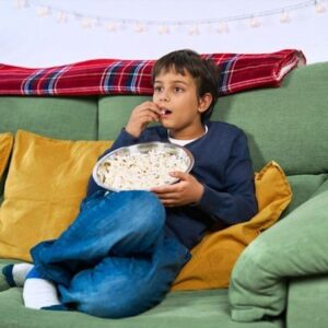 child eating and watching tv
